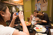 Hongdae. Girls taking souvenir photos in a restaurant.