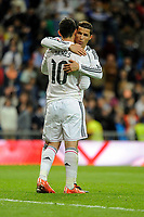 Real Madrid´s Cristiano Ronaldo thank's James Rodriguez after 2014-15 La Liga match between Real Madrid and Malaga at Santiago Bernabeu stadium in Madrid, Spain. April 18, 2015. (ALTERPHOTOS/Luis Fernandez)