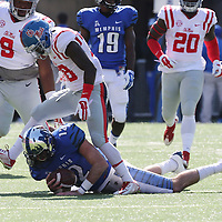 Lauren Wood | Buy at photos.djournal.com<br /> Ole Miss defensive back Mike Hilton steps over Memphis quarterback Paxton Lynch after tackling him during Saturday's game at Memphis.