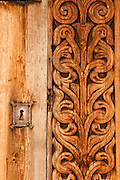 "Keyhole and wood carving. Heddal stave church is Norway's largest stave church. This triple nave stave church, which some call ""a Gothic cathedral in wood,"" was built in the early 13th century and restored in 1849-1851 and the 1950s. Heddal stavkirke is in Notodden municipality, Telemark County, Norway."