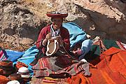 Woman with handicrafts at Sunday market Chinchero, Peru