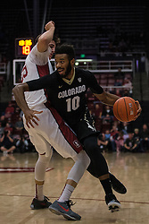 Colorado forward Tre'Shaun Fletcher (10) dribbles past Stanford forward Rosco Allen, left, during the first half of an NCAA college basketball game in Stanford, Calif., Sunday, Jan. 3, 2016. Colorado won 56-55. (AP Photo/Jason O. Watson)