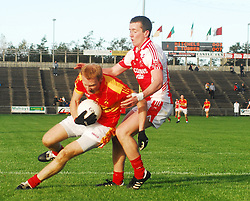 Ballintubber's Cillian O' Connor in action against Castlebar Mitchels Richie Feeney...Pic Conor McKeown