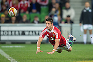 Conor Murray (Lions) makes a mid-air pass during the tour match of the 2013 British And Irish Lions Australian Tour between RaboDirect Melbourne Rebels vs British And Irish Lions at AAMI Park, Melbourne, Victoria, Australia. 25/06/0213. Photo By Lucas Wroe
