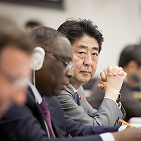 Japanese Prime Minster Shinzo Abe's hands belie his impassive expression after concluding a nuclear non-proliferation meeting addressing the threat of North Korea's missile program during the 72nd UNGA.