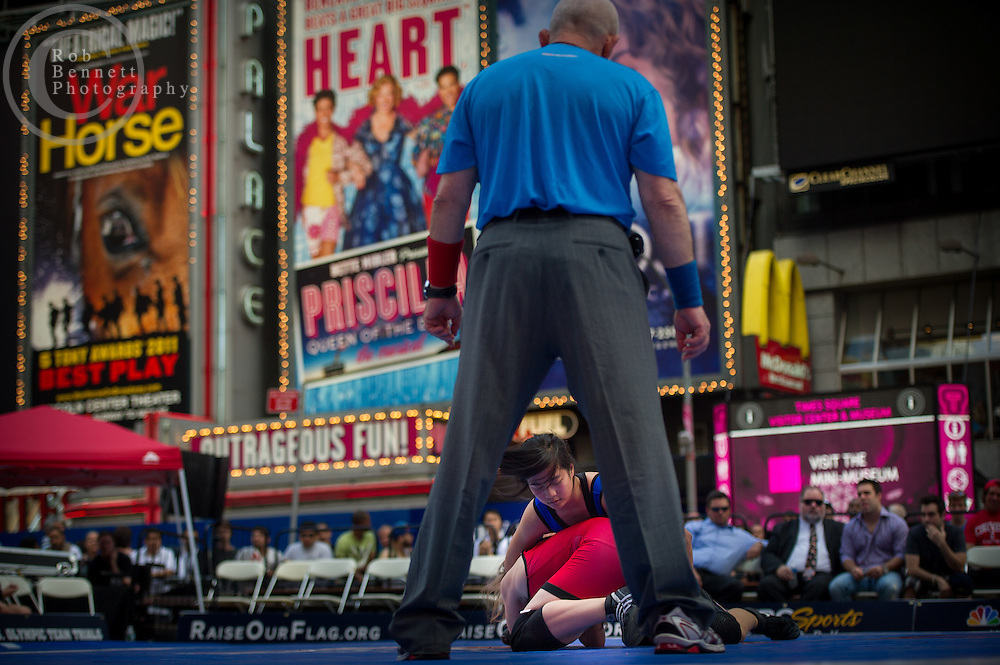 Jun 07, 2012 : Sandy Wu (winner, in blue) and Sara Andersen (red) compete in a youth exhibition wrestling match in Times Square as part of the Beat The Streets 2012 Gala and Benefit. Beat The Streets is a New York City-based not-for-profit organization that has brought wrestling to thousands of middle and high school students in the city. Credit:  Rob Bennett for The Wall Street Journal Slug: TSWrestle