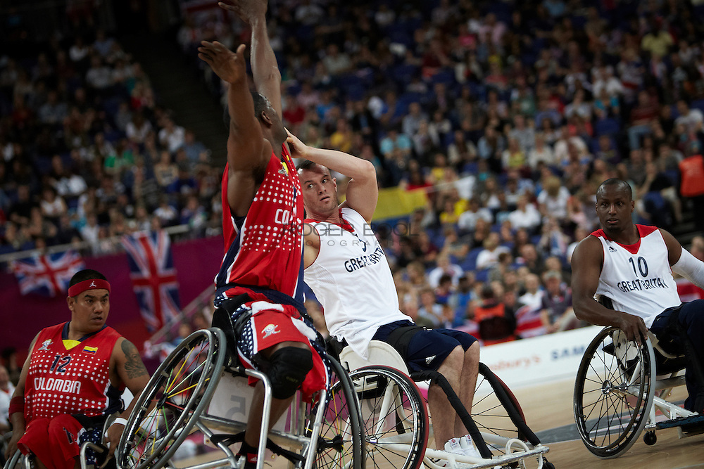 Dan Highcock of Great Britain in the Men's Wheelchair Basketball against  Rodney Hawkins of Colombia at the North Greenwich Arena on day 3 of the London 2012 Paralympic Games. 1st September 2012.
