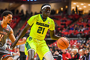LUBBOCK, TX - DECEMBER 29: Nuni Omot #21 of the Baylor Bears handles the ball against Zach Smith #11 of the Texas Tech Red Raiders during the game on December 29, 2017 at United Supermarket Arena in Lubbock, Texas. Texas Tech defeated Baylor 77-53. (Photo by John Weast/Getty Images) *** Local Caption *** Nuni Omot:Zach Smith