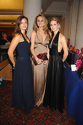 Left to right, LADY NATASHA RUFUS-ISAACS, BRYONY DANIELS and ISABELLE COATEN at a Gala dinner in aid of Chickenshed held at the Guildhall, City of London on 29th October 2007.<br />