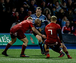 Cardiff Blues' Taufa'ao Filise under pressure from Munster's John Ryan<br /> <br /> Photographer Simon King/Replay Images<br /> <br /> Guinness PRO14 Round 15 - Cardiff Blues v Munster - Saturday 17th February 2018 - Cardiff Arms Park - Cardiff<br /> <br /> World Copyright © Replay Images . All rights reserved. info@replayimages.co.uk - http://replayimages.co.uk