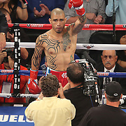 Miguel Cotto of Puerto Rico waits in the center of the ring prior to the 12 round super welterweight bout against challenger Delvin Rodriguez of the Dominican Rebublic, at the Amway Center in Orlando, Florida on Saturday, October 5, 2013. Cotto won by knockout in the 3rd round of the match.(Photo/Alex Menendez)