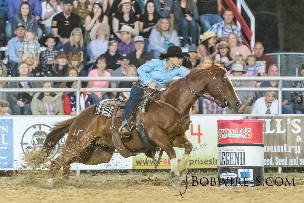 Jessica Wykert makes her run in the barrel racing during the second performance of the Elizabeth Stampede on Saturday, June 2, 2018.