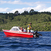 A group fishing from a boat on Lake Toupo,,Toupo, New Zealand,, 8th January 2010 Photo Tim Clayton.