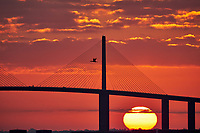 Sun rising under the Sunshine Skyway bridge from Fort De Soto Park in Pinellas County, Florida. Image taken with a Fuji X-T2 camera and 100-400 mm OIS lens