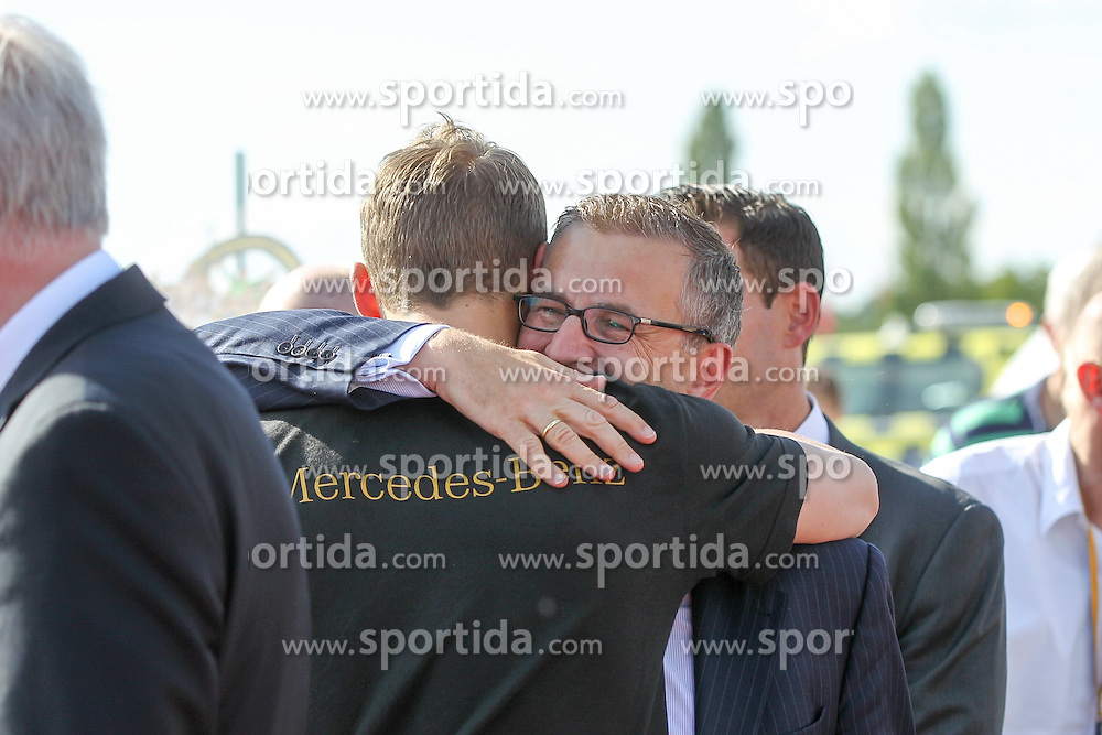 15.07.2014, Flughafen, München, GER, FIFA WM, Empfang der Weltmeister in Deutschland, Finale, im Bild l-r: Manuel Neuer #1 (Deutschland) umarmt stellvertretenden Vorstandsvorsitzenden Jan-Christian Dreesen (FC Bayern Muenchen) // during Celebration of Team Germany for Champion of the FIFA Worldcup Brazil 2014 at the Flughafen in München, Germany on 2014/07/15. EXPA Pictures © 2014, PhotoCredit: EXPA/ Eibner-Pressefoto/ Christian Kolbert<br /> <br /> *****ATTENTION - OUT of GER*****