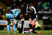Barnsley defender Alfie Mawson injured during the Sky Bet League 1 match between Bradford City and Barnsley at the Coral Windows Stadium, Bradford, England on 26 January 2016. Photo by Simon Davies.