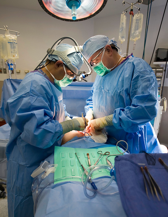 Dr.'s Kahlenberg and Smith during Surgery