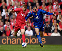 Photo: Jed Wee.<br /> Liverpool v Manchester United. The Barlcays Premiership. 18/09/2005.<br /> <br /> Liverpool's John Arne Riise (L) takes on Manchester United's John O'Shea.