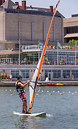 A student wind surfs outside the Terrace at Memorial Union.  Rentals are available through Outdoor UW, in 2014.