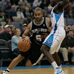Mar 01, 2010; New Orleans, LA, USA; San Antonio Spurs guard Tony Parker (9) drives past New Orleans Hornets guard Darren Collison (2) during the first half at the New Orleans Arena. Mandatory Credit: Derick E. Hingle-US PRESSWIRE