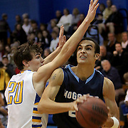 Hoggard's Xavier Johnson drives on Laney's CJ Kirchoff Tuesday at Laney. (Jason A. Frizzelle)