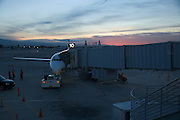 airport Palm Springs airplane at a gate at sunrise
