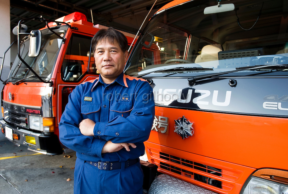 Masamichi Watanabe, chief of the Lake Kawaguchi fire department, stands by fire trucks at his fire station in Yamanashi Prefecture, west of Tokyo, Japan on 04 Nov. 2009. ..