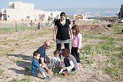 Family plant trees on Arbour Day (Tu Beshvat), Israel