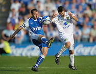 Picture by Ady Kerry/Focus Images Ltd.  .26/09/09.Gillingham's  Barry Fuller challenges Norwich's Wes Hoolahan during their Coca-Cola League 1 game at the Priestfield Stadium, Gillingham, Kent,