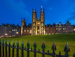 Night view of Edinburgh University New College building on The Mound in Edinburgh Old Town, Scotland, UK