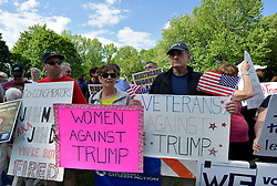 Protesters were gathered across the street from the Lawrenceville National Guard Armory where Donald Trump and NJ Gov. Chris Chirstie were scheduled to make an appearance. Presumptive GOP nominee Donald Trump attends a fundraising event with NJ Gov. Chris Christie at Lawrenceville National Guard Armory in Lawrence Township, NJ