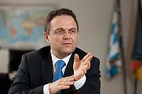 03 JAN 2011, BERLIN/GERMANY:<br /> Hans-Peter Friedrich, MdB, CSU, Vorsitzender der CSU Landesgruppe im Deutschen Bundestag, waehrend einem Interview, in seinem Buero, Jakob-Kaiser-Haus, Deutscher Bundestag<br /> IMAGE: 20110103-01-003