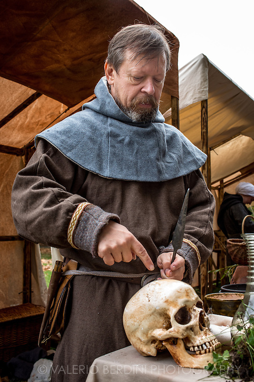 A doctor shows how to operate a skull. It's been 950 years since King Harold got an arrow in the eye at the Battle of Hastings. A group of re-enactors set up a camp near Apsley House in Hyde Park, London, to show their weapons, games and living arrangements.