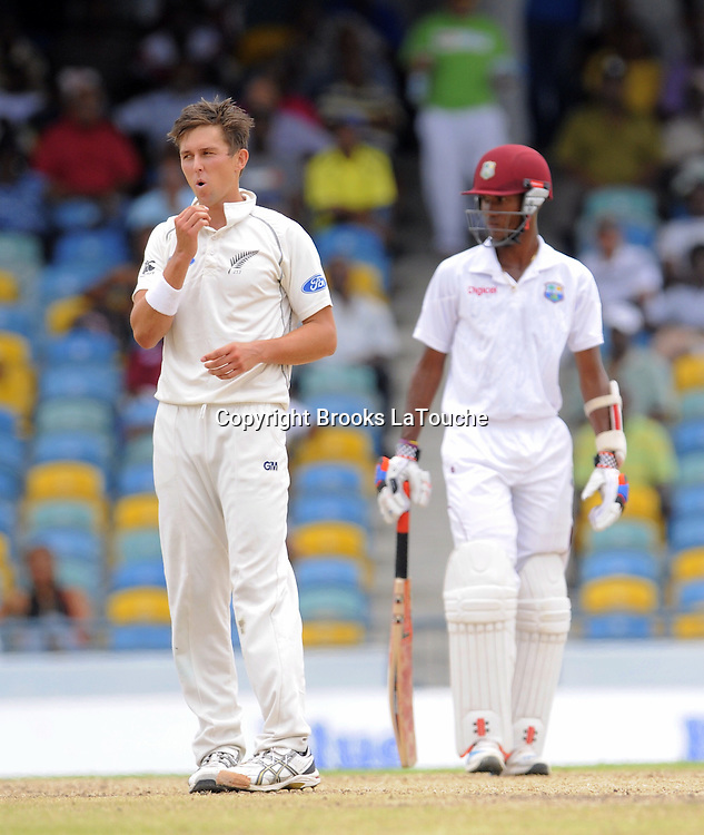 New Zealand bowler Trent Boult disappointed that West Indies batsman get 4 runs during day two of the Third and Final Test West Indies v New Zealand at Kensington Oval, Barbados.<br /> The non-striker is Kraigg Brathwaite.<br /> Photo: Randy Brooks/www.photosport.co.nz