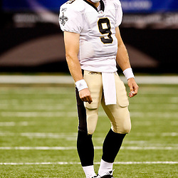 August 21, 2010; New Orleans, LA, USA; New Orleans Saints quarterback Drew Brees (9) on the field during the first quarter of a preseason game against the Houston Texans at the Louisiana Superdome. Mandatory Credit: Derick E. Hingle