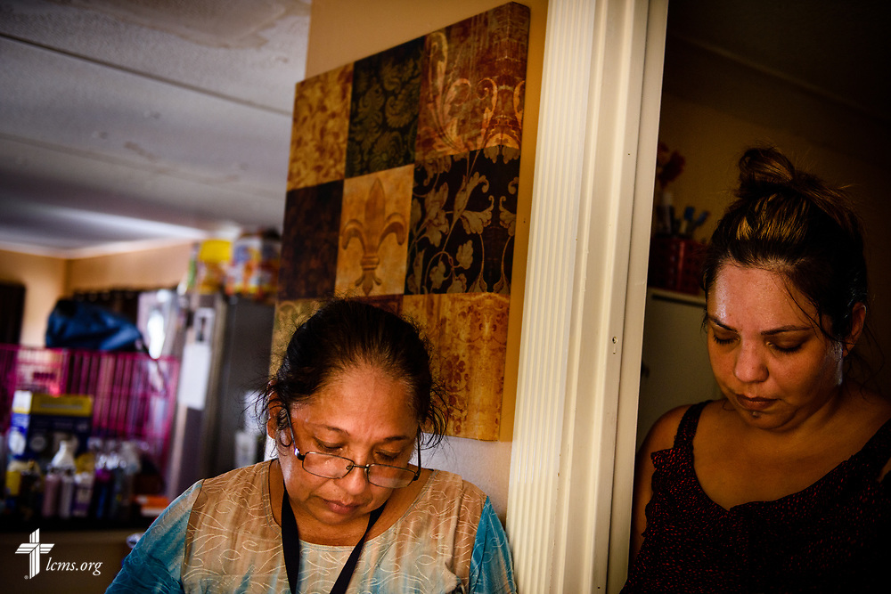 Sonia Cerritos and her daughter Evelyn Cardenas pray at their hurricane-damaged home on Wednesday, Sept. 13, 2017, in Bonita Springs, Fla. LCMS Communications/Erik M. Lunsford