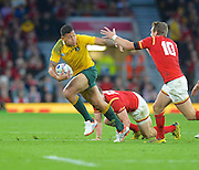 Israel Folau breaks a tackle during the Rugby World Cup Pool A match between Australia and Wales at Twickenham, Richmond, United Kingdom on 10 October 2015. Photo by Ian Muir.during the Rugby World Cup Pool A match between Australia and Wales at Twickenham, Richmond, United Kingdom on 10 October 2015. Photo by Ian Muir.