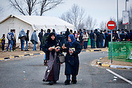 Refugees woman while on their way with a bus from Athens to Idomeni village at the Greece - Macedonian border, 8 Febraury 2016. Hundreds of refugees  wait every day at a gas station used as a temporary camp outside of Polykastro city at the north part of Greece until they receive the order from the police to move to the Greece- Macedonian border and continue their trip  to North Europe.