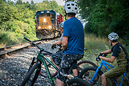 Waiting for a train while urban mountain biking in Grand Rapids, Michigan.