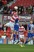 Craig Alcock (38) of Doncaster Rovers and Yanic Wildschut (31) of Wigan Athletic during the Sky Bet League 1 match between Doncaster Rovers and Wigan Athletic at the Keepmoat Stadium, Doncaster, England on 16 April 2016. Photo by Ian Lyall.