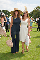 Left to right, CAROL VORDERMAN and NATALIE PINKHAM at the 2014 Glorious Goodwood Racing Festival at Goodwood racecourse, West Sussex on 31st July 2014.