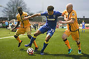 Sutton United Kevin Amankwaah (2) and Sutton United Nicky Bailey (16) tussle with AFC Wimbledon striker Lyle Taylor (33)  during The FA Cup match between Sutton United and AFC Wimbledon at Gander Green Lane, Sutton, United Kingdom on 7 January 2017. Photo by Stuart Butcher.