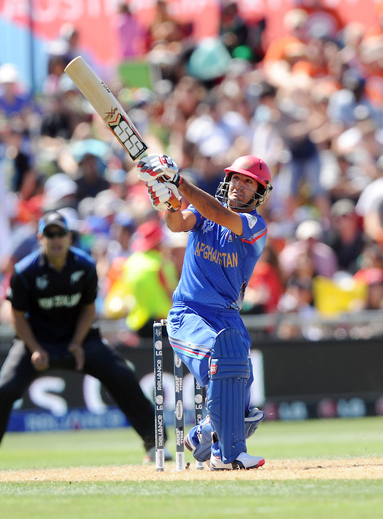 Afghanistan's Najib Zadran hits a six out of the ground against New Zealand in the ICC Cricket World Cup at McLean Park, Napier, New Zealand, Sunday, March 08, 2015. Credit:SNPA / Ross Setford