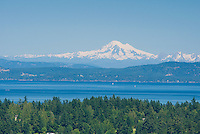 Looking over the Saanich peninsula on Vancouver Island towards the San Juan Islands and the Strait of Juan de Fuca.  Mount Baker in the background.