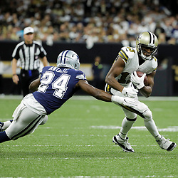Sep 29, 2019; New Orleans, LA, USA; New Orleans Saints wide receiver Michael Thomas (13) runs past Dallas Cowboys cornerback Chidobe Awuzie (24) during the first quarter at the Mercedes-Benz Superdome. Mandatory Credit: Derick E. Hingle-USA TODAY Sports