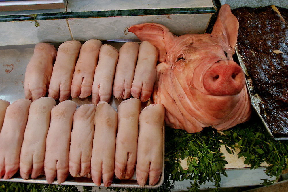 Pig parts and lard are displayed for sale in the municipal market in Cuernavaca, Mexico. (From the book What I Eat: Around the World in 80 Diets.) Although meat in the United States and Europe mainly comes from factory farms and is sold in shrink-wrapped packages, most animal products elsewhere?as these photographs demonstrate?come from small-scale producers and are sold by butchers.