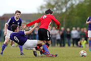 City of Liverpool's (purple) Jamie McDonald and  Litherland's Stephen Ferrigan (Red) during the North West Counties League Play Off Final match between Litherland REMYCA and City of Liverpool FC at Litherland Sports Park, Litherland, United Kingdom on 13 May 2017. Photo by Craig Galloway.