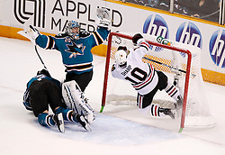 May 18, 2010; San Jose, CA, USA; Chicago Blackhawks left wing Patrick Sharp (10) falls into the net while San Jose Sharks defenseman Douglas Murray (3) and goaltender Evgeni Nabokov (20) collide during the first period of game two of the western conference finals of the 2010 Stanley Cup Playoffs at HP Pavilion.  The Blackhawks defeated the Sharks 4-2. Mandatory Credit: Jason O. Watson / US PRESSWIRE