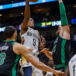 Mar 18, 2018; New Orleans, LA, USA; New Orleans Pelicans guard Rajon Rondo (9) shoots over Boston Celtics center Aron Baynes (46) and forward Jayson Tatum (0) during the first quarter at the Smoothie King Center. Mandatory Credit: Derick E. Hingle-USA TODAY Sports
