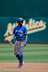 OAKLAND, CA - JULY 23:  Jose Reyes #7 of the Toronto Blue Jays leads off second base against the Oakland Athletics during the first inning at O.co Coliseum on July 23, 2015 in Oakland, California. The Toronto Blue Jays defeated the Oakland Athletics 5-2. (Photo by Jason O. Watson/Getty Images) *** Local Caption *** Jose Reyes